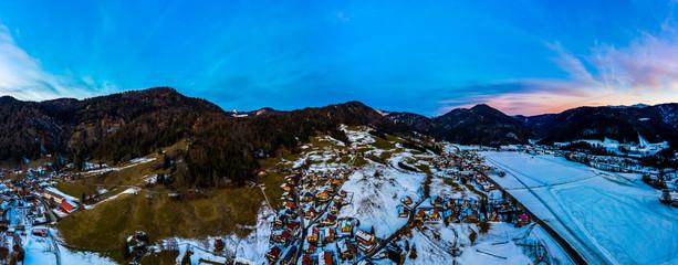 Aerial view, Snowy Reit im Winkl at dusk, Chiemgau, Upper Bavaria, Bavaria, Germany