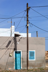 House behind electricity pole in Cape Verde