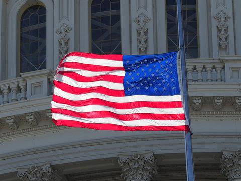 US capitol American flag half-mast.