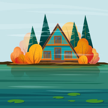Autumn landscape with a  A-frame house at the lakeside