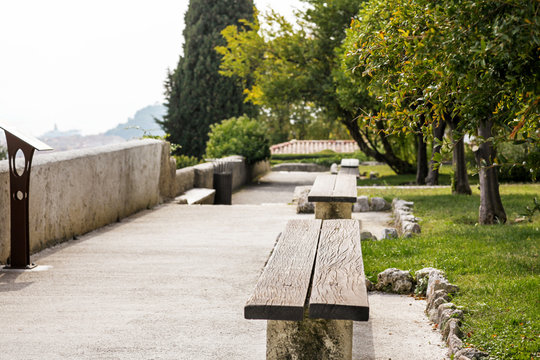 Garden with benches in a monastery on the hill of Cimiez in Nice, France.