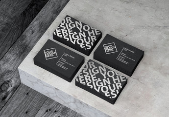 Four Stacks of Black Textured Business Cards Mockup on Concrete