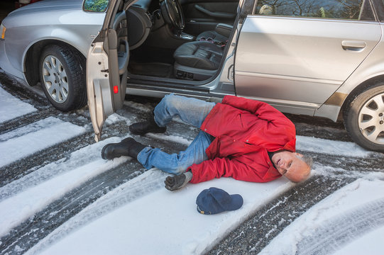 Senior man slipped on ice coming out of his car