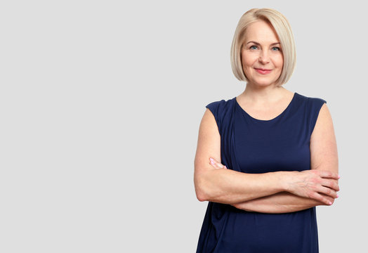 Friendly smiling middle-aged business woman isolated on white ba