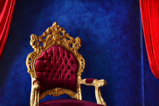 Luxury classical interior with blue wall and purple-golden chair. Extraordinary Blue And Purple Interior. Blue and red contrast with walls.Expensive home interior with violet armchair.