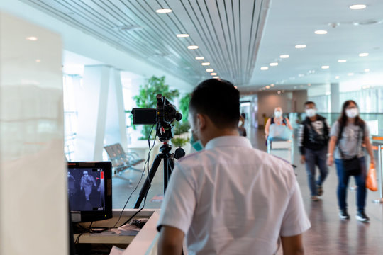 Airport medical staff detect incoming passengers body temperature with thermal camera equipment prevent the spread of the coronavirus outbreaks