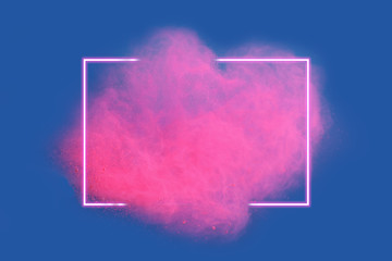 Pink neon powder explosion with gliwing frame on blue background. Colored cloud. Colorful dust explode. Paint Holi.