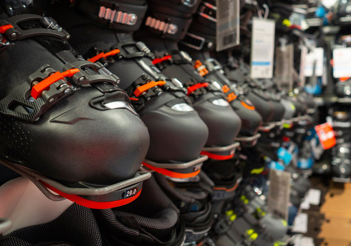 row of ski boots in the sports store, original sports equipment