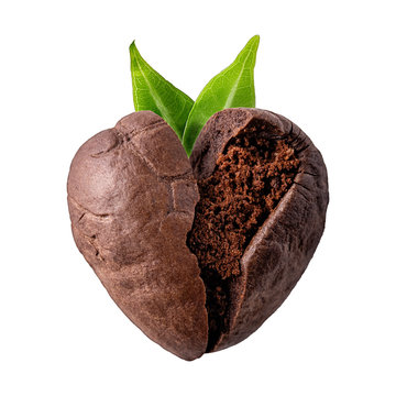 Heart shaped coffee bean with green leaves on a white isolated background. Close-up. Coffeemania.