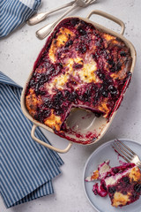 Cottage cheese casserole with blueberries in baking dish