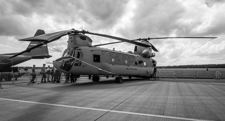 BERLIN, GERMANY - JUNE 02, 2016: The twin-engine, tandem rotor heavy-lift helicopter Boeing CH-47 Chinook. US Army. Black and white. Exhibition ILA Berlin Air Show 2016