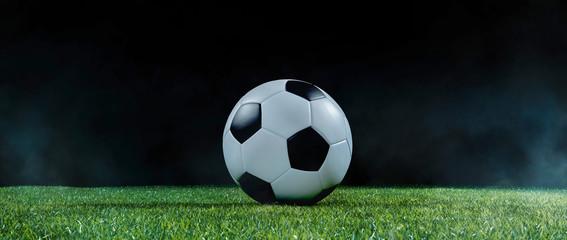 Traditional football on an illuminated sports field at night