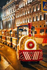 Foto op Aluminium Londen rode bus Street in Saint-Petersburg eith train