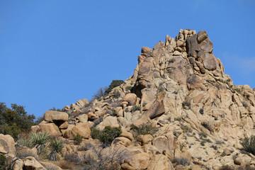 a blue sky and mountain top ridge close-up