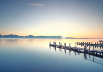 Three Wooden piers or jetties at sunrise. Torre del Lago Puccini, Versilia Tuscany, Italy