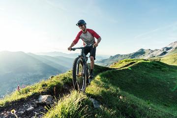 Mountain biker on a way in Grisons, Switzerland
