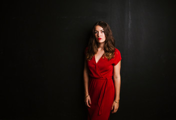 Portrait of young woman wearing red dress