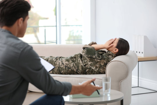 Psychotherapist working with female military officer in office