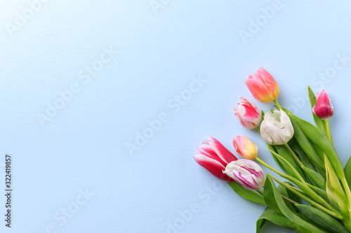 Spring, Women, Mother's day, DIY, holidays preparation and creativity layout. Festive decorations, tulips on blue, mockup greeting card, flat lay with empty space for text design