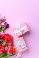 Spring creative holiday present. Handmade paper gift box with floral decorations on pink. Mother's...