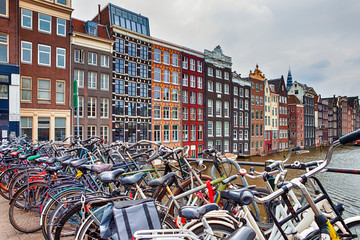 Canvas Prints Amsterdam Traveling Through the Netherlands. City of Amsterdam. Lots of Bicycles in line Along the Damrak Street of Amsterdam.