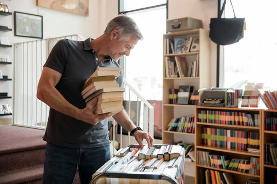 Business owner working in independent book store