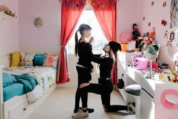 Girl helping sister with Halloween makeup