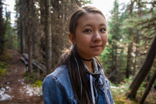 Portrait confident girl hiking in woods