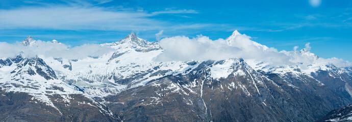 Aluminium Prints Blue Panorama of snow mountain in Swiss