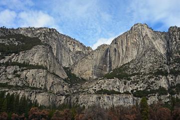 Yosemite Falls and surrounding granite rock formations in Yosemite National Park, California in winter.