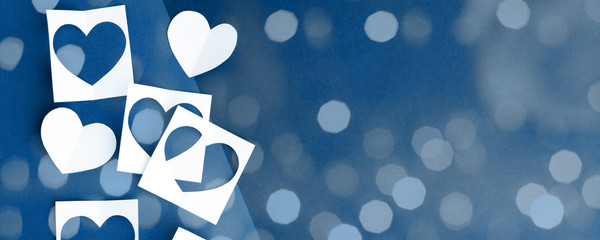 Paper hearts on classic blue background. Empty place for copy space for text. mock-up, minimal concept of romance winter february holiday. saint Valentine day, banner