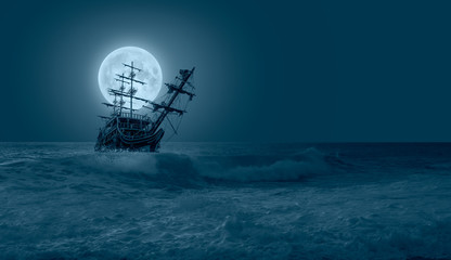 """Sailing ship in storm sea against full moon """"Elements of this image furnished by NASA"""""""