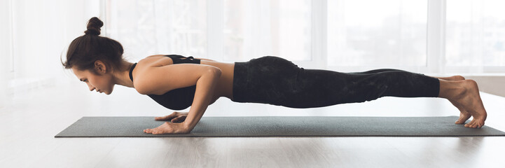 Woman doing plank exercise or push ups