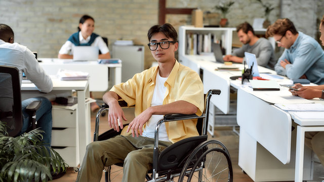 Work for yourself, not by yourself. Guy in a wheelchair working in the office