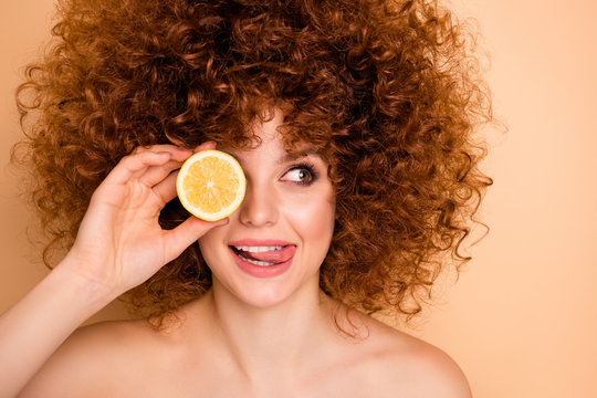 Close up photo beautiful funky she her wear no clothes lady hold hide eye behind slice lime lemon tongue out mouth look side stylist curls perms roller curlers tint isolated beige pastel background