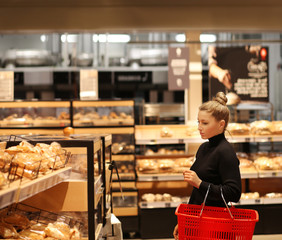 Woman choosing bread from a supermarket