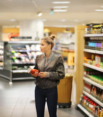 Woman choosing a dairy products at supermarket