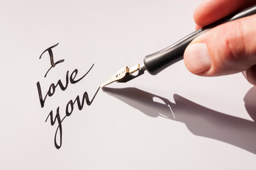 Romantic I Love You message handwritten in black ink with a calligraphy pen
