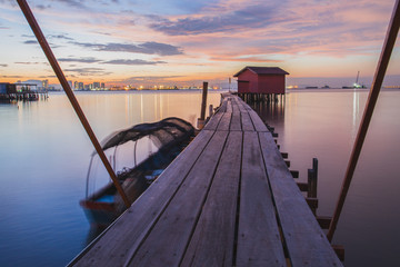Wooden bridge with hut at sunrise in Chew jetty Georgetown Penang.