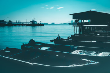 Silhouette landscape in moody green at Chew jetty in Penang.
