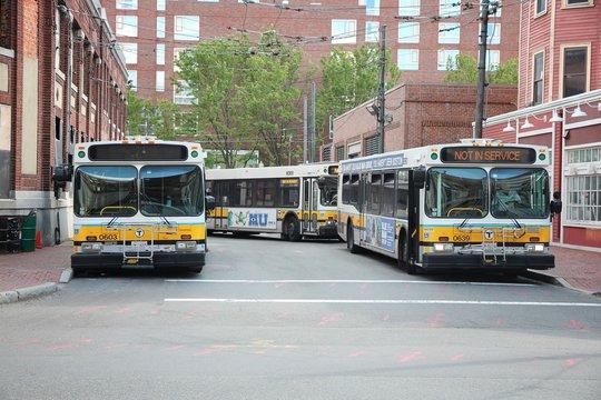CAMBRIDGE, USA - JUNE 9, 2013: Boston city buses (MBTA Bus) in Cambridge, MA. MBTA Bus operates on 177 lines.