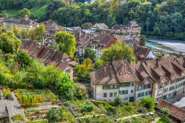 View of Bern from a hill with the Aare river, the traditional roofs and gardens