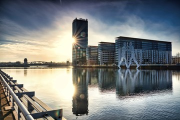 Berlin Allianz Treptowers with the Molecule Men near the Treptower Park on the Spree in the sunrise