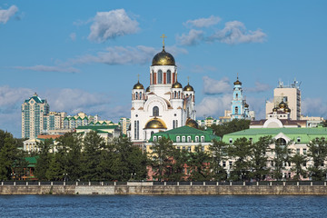 Yekaterinburg, Russia. Church on Blood, Ascension Church, Patriarchal Metochion and Rastorguyev-Kharitonov Palace. View from city pond. Text on facade reads: They have poured out their blood as water.