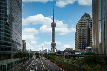 Wall Mural - Shanghai city and tower with a road and building