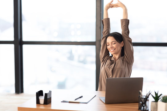 Happy american girl stretching body at her home