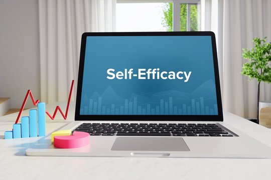 Self-Efficacy – Statistics/Business. Laptop in the office with term on the Screen. Finance/Economy.