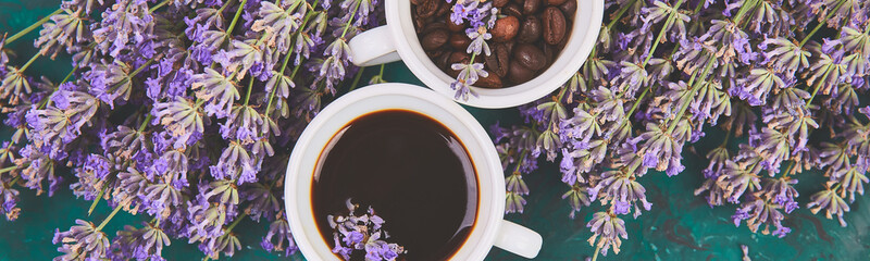 Banner of Coffee, coffee grain in cups and lavender flower on green background