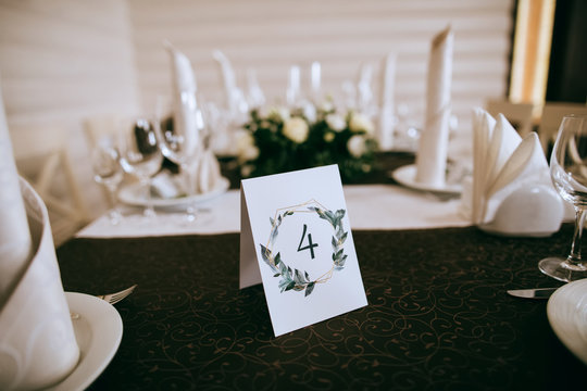 Wedding table with white flowers with table number. Wedding decoration