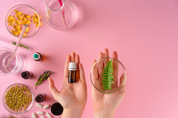 Herbs and Herbal dietary supplements top view on pink background